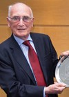 Photo showing award of an inscribed silver salver tray from the University of Edinburgh to Barry Cullen.